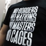 T-Shirt - No Borders, No Nations, No Masters, No Slaves